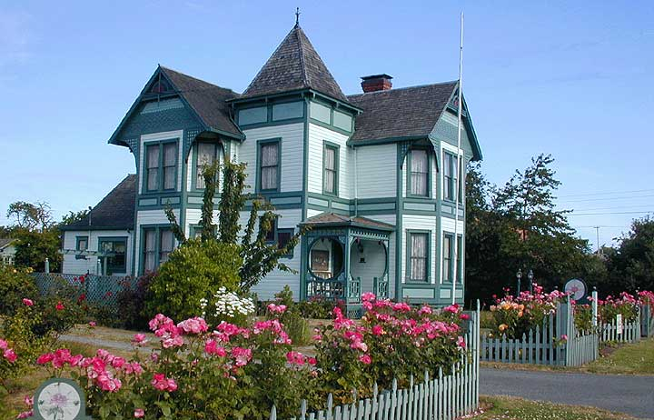 The Composs Rose Bed and Breakfast in Coupeville Washington.  View of the Inn with its Rose Bushs